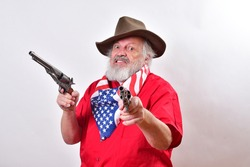 A Western rancher wearing a patriotic bandana has two pistols with one pointing at the camera.A mean looking old man with a viscous snarl point one pistol at the camera and the other to his right.