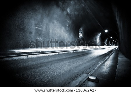 A wet tunnel, lightened only by the lamps