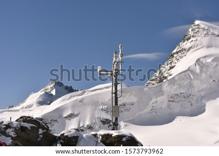 A wether station on Mountain peek of Alps,  Jungfraujoch is a saddle in the Bernese Alps, connecting the two four-thousander peaks Jungfrau and Mönch, at an elevation of 3,466 metres above sea level. #1573793962