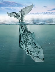 a whale of garbage plastic floating in the ocean