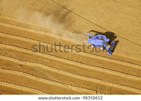 A wheat field being harvested