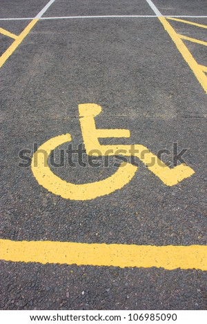 A wheelchair disability sign, signifies a car parking space reserved for disabled.