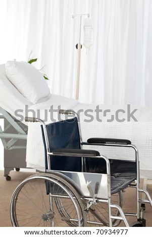 A wheelchair in a room - stock photo