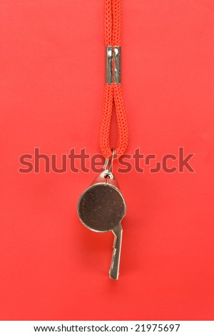 a whistle with red background
