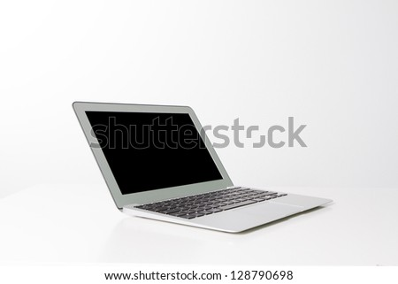 a white, black and grey laptop isolated