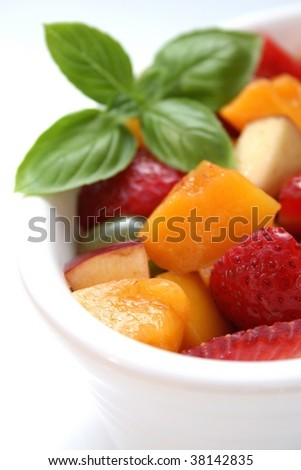 A white bowl of freshly chopped fruit salad