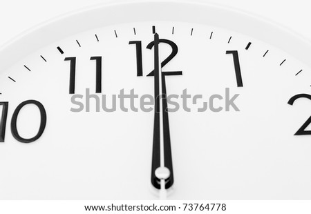 a white clock - twelve o'clock (midnight or midday)