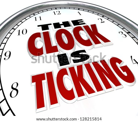 A white clock with the words The Clock is Ticking to symbolize an impending deadline or end to an event or period