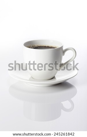 A white coffee cup and black coffee on the reflect bottom isolated white at the studio. #245261842