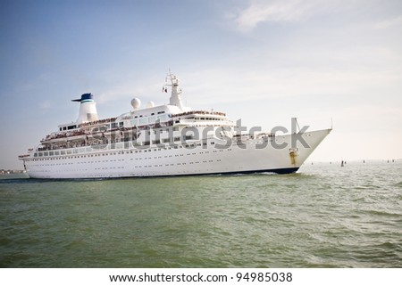 A white cruise ship floating in the sea