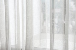 A White curtain textural background on window.