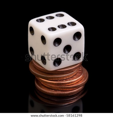 A white dice on the cooper coins