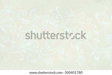 A white floral background with abstract flowers and curls on ivory or beige color paper in a beautiful wedding design with a hand drawn lacy pattern of curves and lines in a faint flourish.