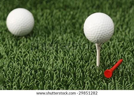 A white golf ball on a tee. A macro image.