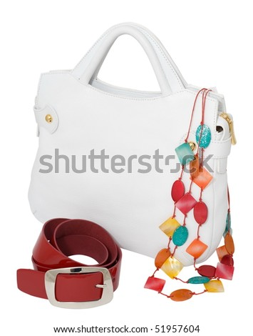 a white ladies handbag with a red belt and a coloured necklace, isolated on white, clipping path