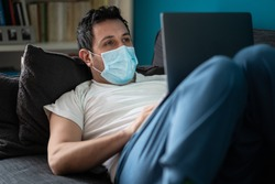A white man is working from home during Coronavirus or Covid-19 quarantine, coronavirus covid 19 infected patient in coronavirus covid 19 quarantine room using computer