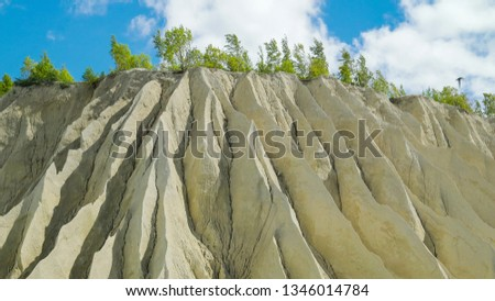 A white mountain of white stones in Rummu Vasalema Estonia. The erosion from the quarry in the limestone quarry #1346014784