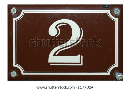 A white number 2 on a brown background plate, held in place by four screws