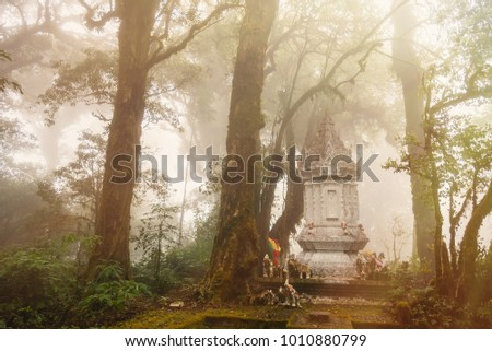 Shutterstock A white pagoda shrine of guardian god in the middle of the jungle.Thailand