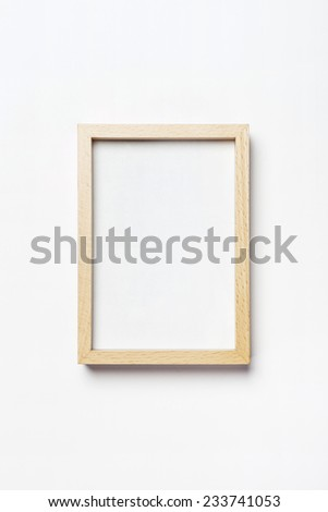 A white photo(picture) frame isolated white, top view at the studio.