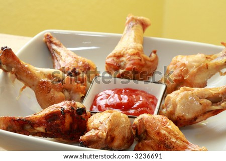a white plate of bbq chicken with sauce