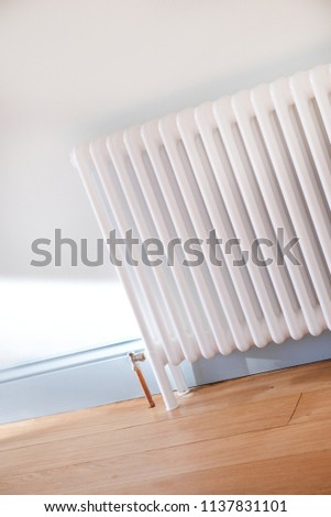 a white radiator in a  newly decorated room #1137831101