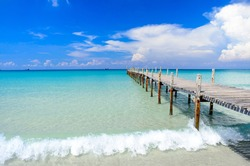 A white sand beach with blue sky and clear water sea landscape at Ao Phrao beach on Koh Kood island in Gulf of Thailand