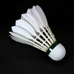 a white shuttlecock isolated on black