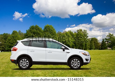 A white SUV in the green field