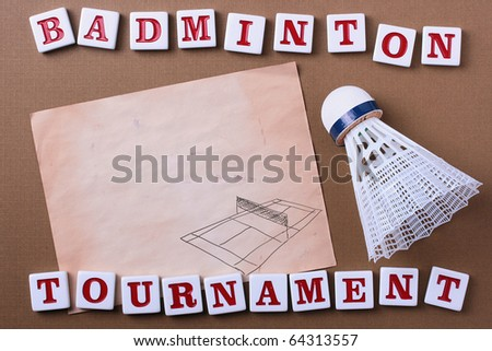 A white synthetic badminton shuttlecock next to a piece of paper. Add your text to the paper.