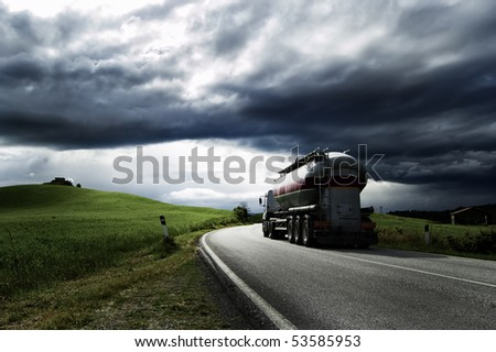 A white truck run on a road