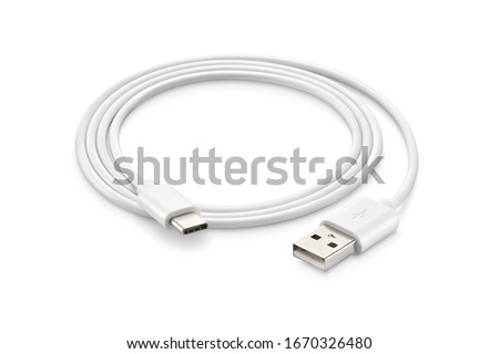 A white USB type C charger cable, compatible for many devices, wrapped in a spiral shape, isolated on white background. Stock photo ©