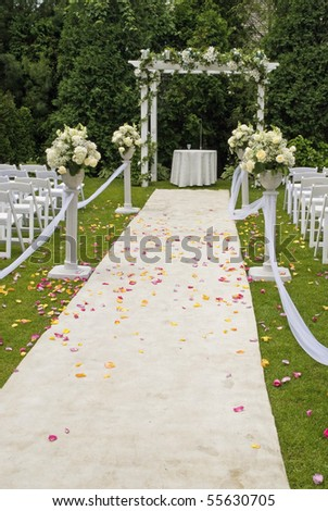 stock photo A white wedding carpet covered in rose petals and the scene of