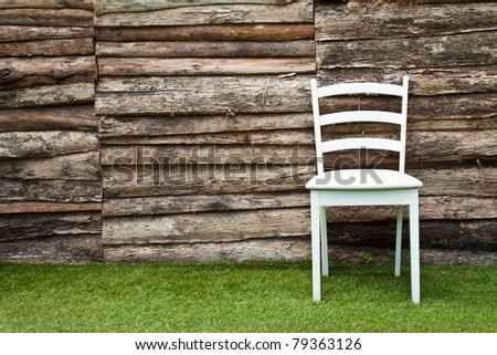 A white wood chair in living room on green grass
