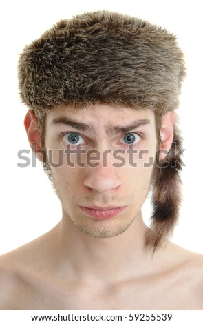 A white young male wears a raccoon hat isolated on white background