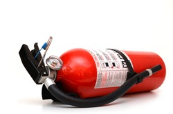 A whole fire extinguisher home lay down on white