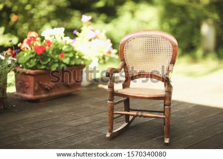 A wicker chair on wooden decking