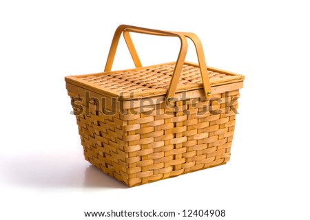 A wicker picnic basket on a white background with copy space