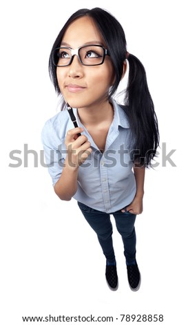 A wide angle full body shot of a nerdy Asian student holding a pen and looking up and away.