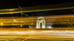 A wide angle long exposure shot of India Gate (formerly known as the All India War Memorial) with light trails of moving vehicles at Rajpath, New Delhi, India.