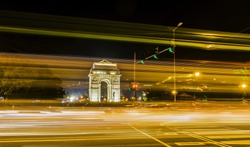 A wide angle long exposure shot of India Gate (formerly known as the All India War Memorial) with light trails of moving vehicles at Rajpath road, New Delhi, India.