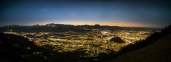 a wide angle panorama of salzburg by night, shot from mt. gaisberg