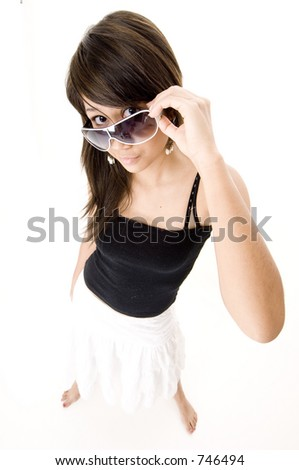 stock photo : A wide angle shot of a cool teen in sunglasses