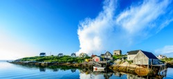 A wide angle view of a  calm summer evening in the fishing village of Peggys Cove, Nova Scotia.