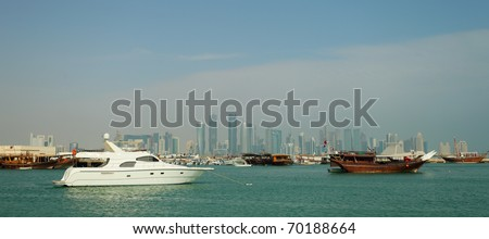 A wide-angle view of Doha harbour, Qatar, January 2011, with the high-rise city skyline in the distance.