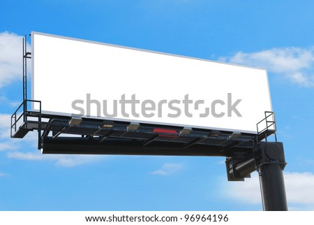 A wide blank billboard against blue sky