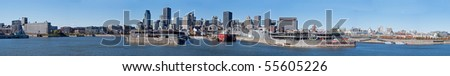 A wide, panoramic view of the Montreal, Quebec waterfront. - stock photo