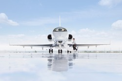 A wide shot of pilot boarding a private jet on a runway.