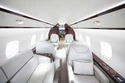 A wide shot showing interiors of a private jet.