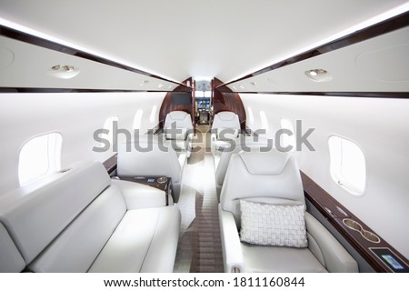 A wide shot showing interiors of a private jet. Photo stock ©